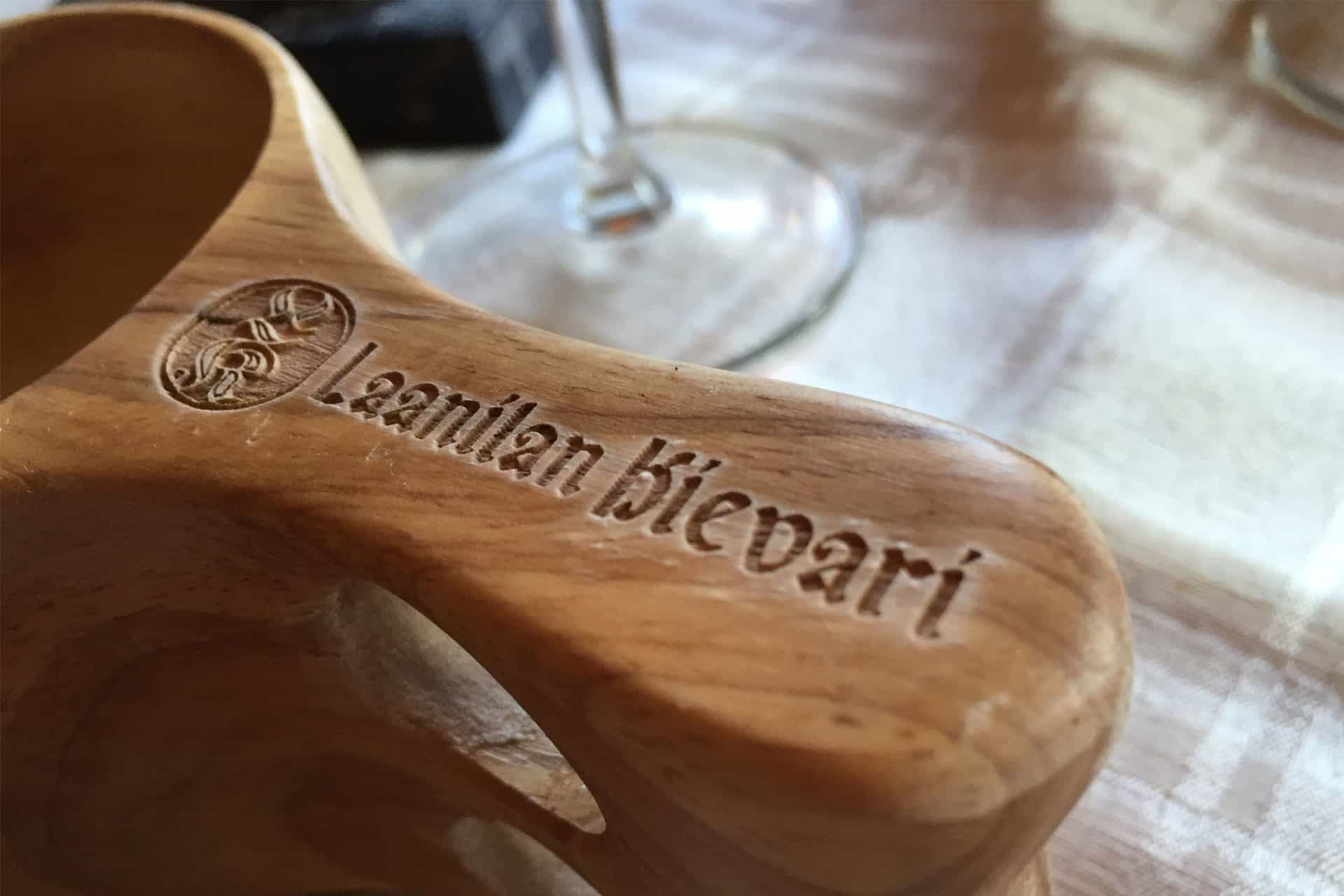 The restaurant Name is craved on a traditional finnish cup Kuksa - Laanilan Kievari