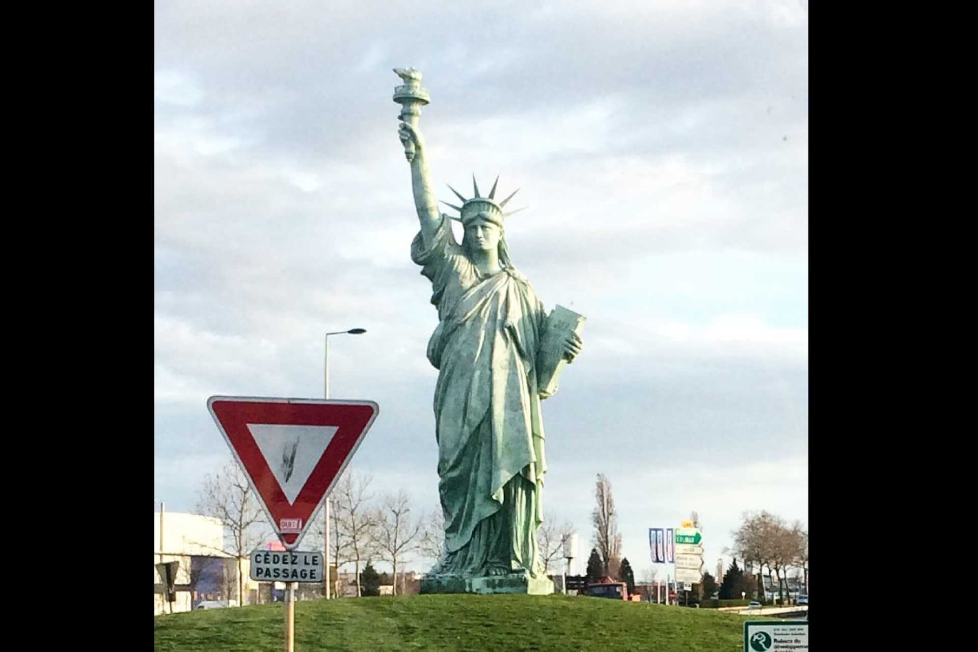 "12-meter high replica of the Statue of Liberty. It was sculpted to commemorate the 100th death anniversary of the sculptor Auguste Batholdi, who was born in Colmar and created the ""Liberty lightening the world"". Took this photo on a bus ride coming into Colmar."